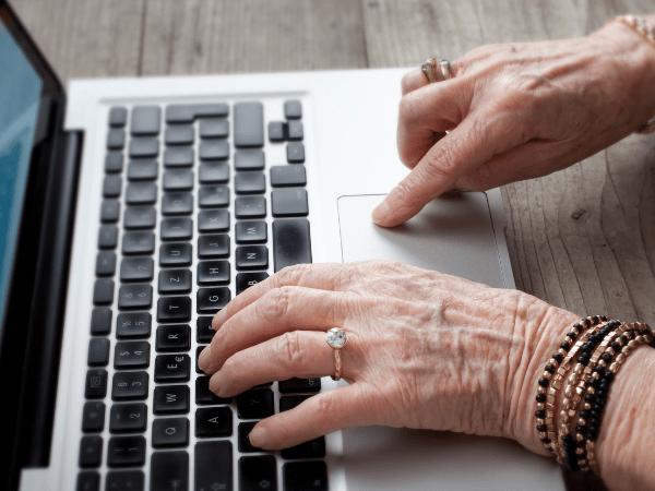 senior citizen aged wrinkled fingers